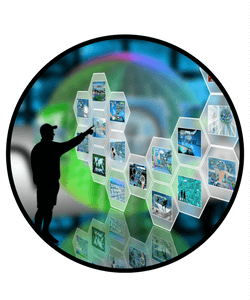 Man standing at an colorful blue and green video wall display.